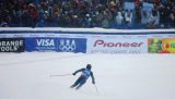 U.S. skier Bode Miller (#26) slides to a stop in front of a decidedly American crowd at the finish...