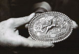 Bruce Ford holds his bareback championship belt buckle from 1983. He also won the title in 1979,...