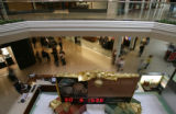 A clock in the Cherry Creek Mall displays the number of days, hours, minutes and seconds left in...