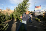 Connie McKee, and Robin Przyhocki, cq, of Cherry Creek Ranch Christmas Trees in Denver setup up...