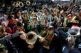 Part of the 400 tuba players take part in the 32nd annual TubaChristmas Sunday afternoon December...