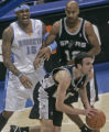 Denver's Carmelo Anthony, left, after having his shot blocked and taken away by San Antonio's Manu...