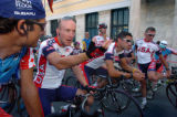 (ATHENS, GREEECE, AUGUST 11, 2004)   USA Road Cyclist, Levi Leipheimer, second from left, talks...