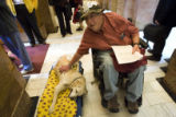 DLM9209  Mike McCarty with the Colorado Developmental Disabilities Council pets Boone, a...