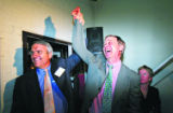 Colorado Governor Bill Ritter holds up the arm of Denver Mayor John Hickenlooper after...