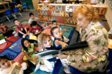 (DENVER, Colo., Aug. 26, 2004)  Substitute teacher Lenore Mahan (right) of Arvada reads to a group...