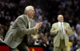 San Antonio Spurs head coach, Gregg Popovich, left, yells directions to his team as Denver Nuggets...