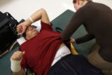 MJM053  Tommy Urbanski (cq) has an area where a chest tube was by physical therapist, Audrey...