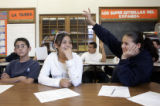 John Dominguez (cq), 13, left, Karina Guardado (cq), 13, and Alejandra Almanza (cq), 13, seventh...