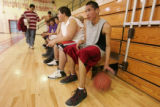 Ethan Traversie (cq) right, plays with a ball waiting to scrimmage during practice at the gym at...
