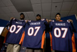 DLM0345  Denver Broncos' 2007 draft picks Jarvis Moss (cq), from left, Timothy Crowder (cq) and...