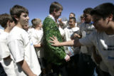 Students from Slavens K-8 school check out Denver Mayor John Hickenlooper's leaf coat that he wore...