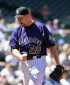 Rockies starting pitcher Aaron Cook reacts to walking Dodgers Andre Ethier, with the bases loaded,...
