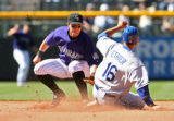 Rockies short stop, Troy Tulowitzki, tags out Dodgers Andre Ethier, trying to steel second base in...
