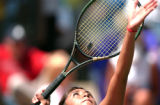 (Denver, Colo., May. 14, 2004) Kim Romero, Pomona, Sr., serves the ball during quarterfinal action...