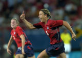 (ATHENS, GREECE- AUGUST 26,2004) United States' #16, Abby Wambach, right, and #13, Kristine Lilly,...