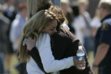 BG0893 Freshman Melissa Madrill, 15, left, re-unites with her mother Jennie Meyens, right, at a...