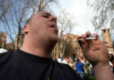 Former CU student Dan Hart (cq),24, enjoys a smoke as thousands of people showed up to smoke pot...