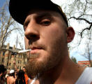 CU student Dan Powers (cq), 21, enjoys a smoke as thousands of people showed up to smoke pot on ...