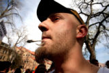 CU student Dan Powers (cq),21, enjoys a smoke as thousands of people showed up to smoke pot on...