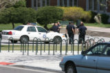 Police were out in force at the front of the high school. Ten marked cars were counted at noon....