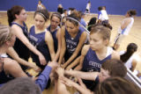 The girls team  from the  Cheyenne River Reservation in S.D. huddle before the second half of a...