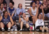 The girls team cheers as  Coree Straight Headdropped a fade away shot in the second OT of a...