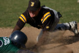 Thomas Jefferson 3rd baseman Dustin Burns tags out Kennedy's Cisco Gallegos at 3rd base in the...