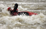 Tyler Clark (CQ), 25, kayaks the swell at the Platte River  riding the water ripping at Union...