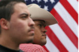 (at right) 26 year-old Jose Luis Mu–oz (cq) listens to a live concert as the 5 de Mayo...