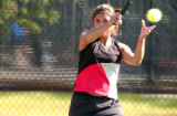 (DENVER, Colo., May 14, 2004) Kim Romero, Pomona, Sr., makes a return on the ball during first...