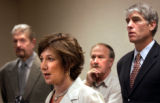 ( DENVER CO., August 12, 2004)   (  back L-R) Cancer patient Thomas Holliday, Dr. Jim Musick, and ...