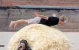 Matt Fischer, (cq), rides atop the giant ball as Zach Grimm, (cq), takes a break and a snack. The...