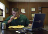 (BYERS, Colo., May 14, 2004)   Dr. Jeff  Perry, Superintendent of Byers School District 32J, eats...