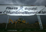 A sign outside the Columbine Memorial asking for donations at Clement Park in Littleton, Colo., on...