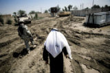 (NYT51) JUWAYBA, Iraq  -- May 7, 2007 -- IRAQ-SHEIK-HOUSE -- Escorted by an American soldier,...