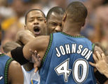 (Denver,CO,Shot On 4/27/04-- Nuggets player Marcus Camby (left) tries to hold back Francisco Elson...