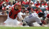 MOJR101 - St. Louis Cardinals catcher Gary Bennett, left, tags out Colorado Rockies' Brad Hawpe at...