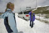 Karla Balk got her car stuck in the snow talks to her daughter Kelsey Balk,17 on a frontage road...