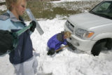 Karla Balk with bare ground only ten feet away, got her car stuck on a frontage road north of...
