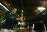 Standley Lake High School swimmer Sam Wilson (cq) (at left), receives the honorary pineapple from...