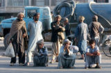 HRT101 - Afghan laborers wait to be hired on the street corner in the main city of Herat province,...