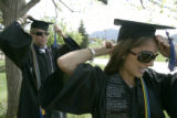0064 Samira Rajabi, CQ, 21, right, prepares for the graduation ceremony with classmate Steve...