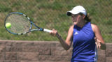Kaitlin Wooldridge, Poudre  High School, hits the ball during her quarterfinal match against...