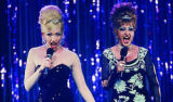 In Connie and Carla, Toni Collette, left, and Nia Vardalos are women disguised as drag queens who...