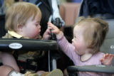 Far more interested in each other than the legislative process, 17 month old William McCarthy,...