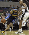 San Antonio's Bruce Bowen applies pressure to Denver's Allen Iverson in the second quarter of play...