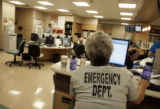 Nurse Karla Lewis (cq) enters patient information in the emergency room at Swedish Medical Center...