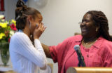 L to R: Alicia Taylor (cq) cries while standing next to  her foster mom, Cherry Charles (cq)...