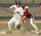 Columbin's Curtis Cunningham, left, is safe at third beating a throw to Rocky Mountain third...